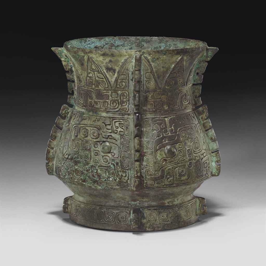 A rare and finely cast bronze ritual wine vessel, zhi, late Shang dynasty, 12th-11th century BC