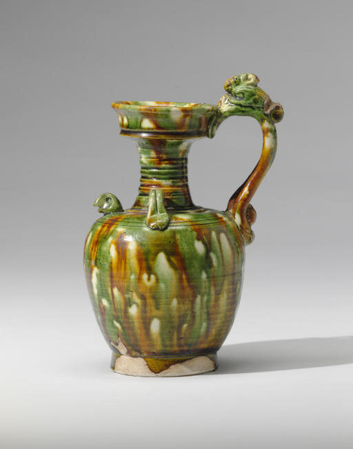 A rare sancai-glazed pottery phoenix-handled ewer, Tang dynasty (618-907)