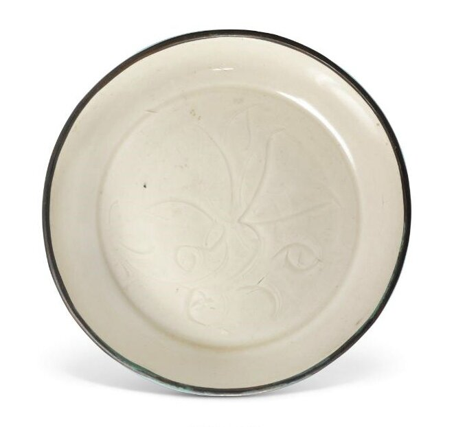 A carved 'Ding' 'Floral' dish, Northern Song dynasty (960-1127)