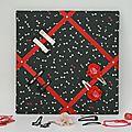 Cadre barrettes noir motif noeuds ruban rouge