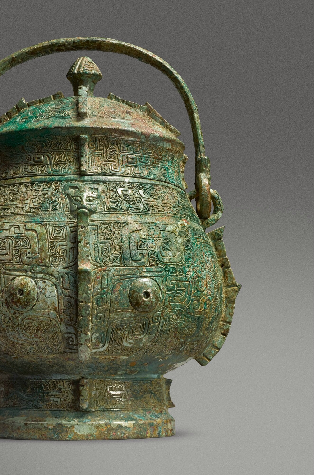 An extremely rare and important bronze ritual wine vessel and cover (you), Shang dynasty