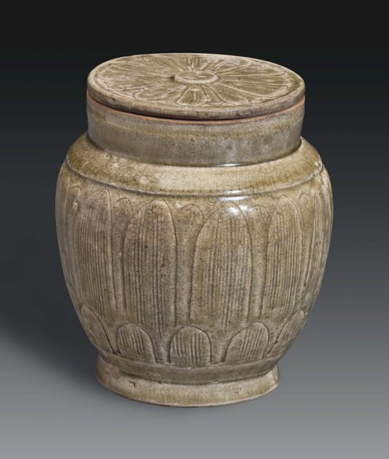 A Longquan celadon carved jar and cover, China, Five Dynasties-Northern Song Dynasty, 10th-11th century