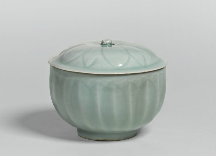 A 'Longquan' celadon carved 'Lotus' bowl and cover, Southern Song dynasty