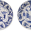 Two chinese blue and white porcelain 'equestrian' dishes, qing dynasty, kangxi period (1662-1722)