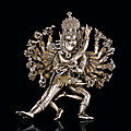 An important gold-inlaid silver figure of hevajra, tibet, circa 15th century