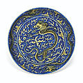 A yellow-enameled blue-ground 'dragon' dish, kangxi six-character mark and of the period (1662-1722)