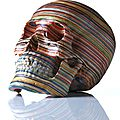 A skull made from repurposed skateboard decks by haroshi
