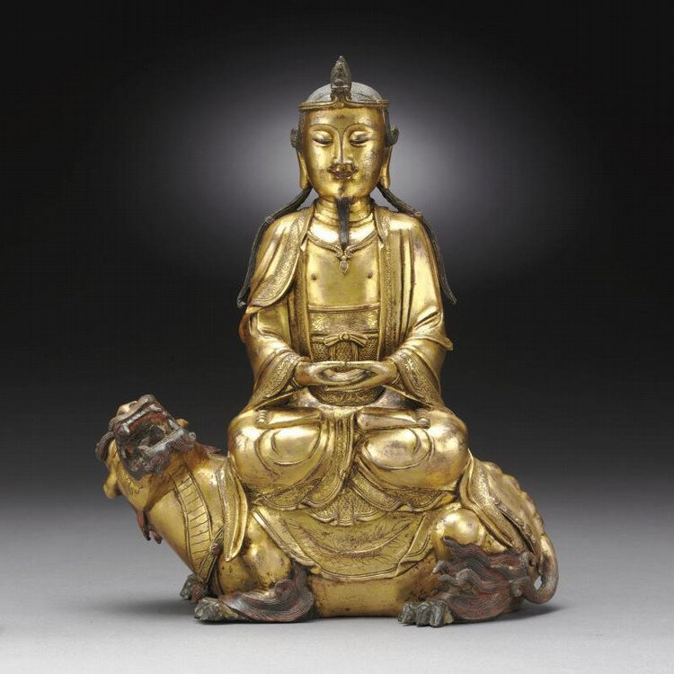 A rare gilt-bronze 'Avalokitesvara and qilin' group, Yuan-Early Ming Dynasty, 14th Century