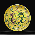 A rare large yellow, green and aubergine-glazed 'dragon' dish, kangxi six-character mark and of the period (1662-1722)