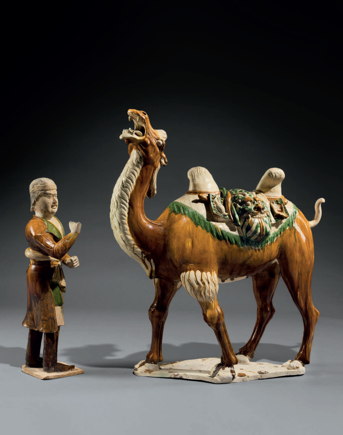 A Rare Sancai-Glazed Figure of a Camel and Groom, Tang dynasty (618-907 AD)