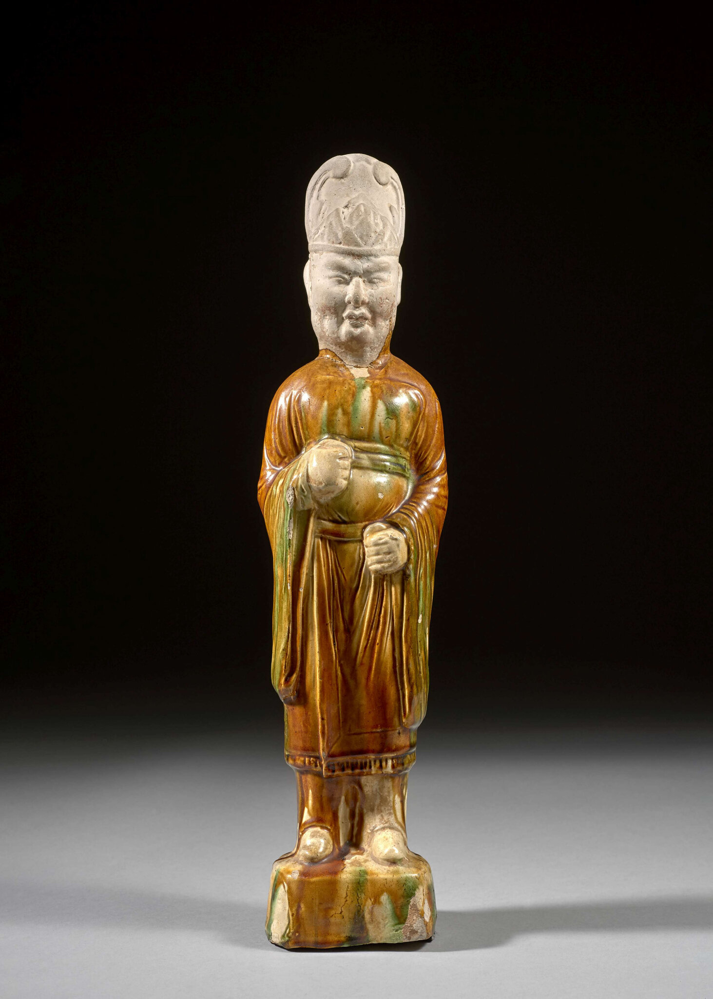 A Sancai glazed pottery figure of an official, Tang dynasty (618-907)