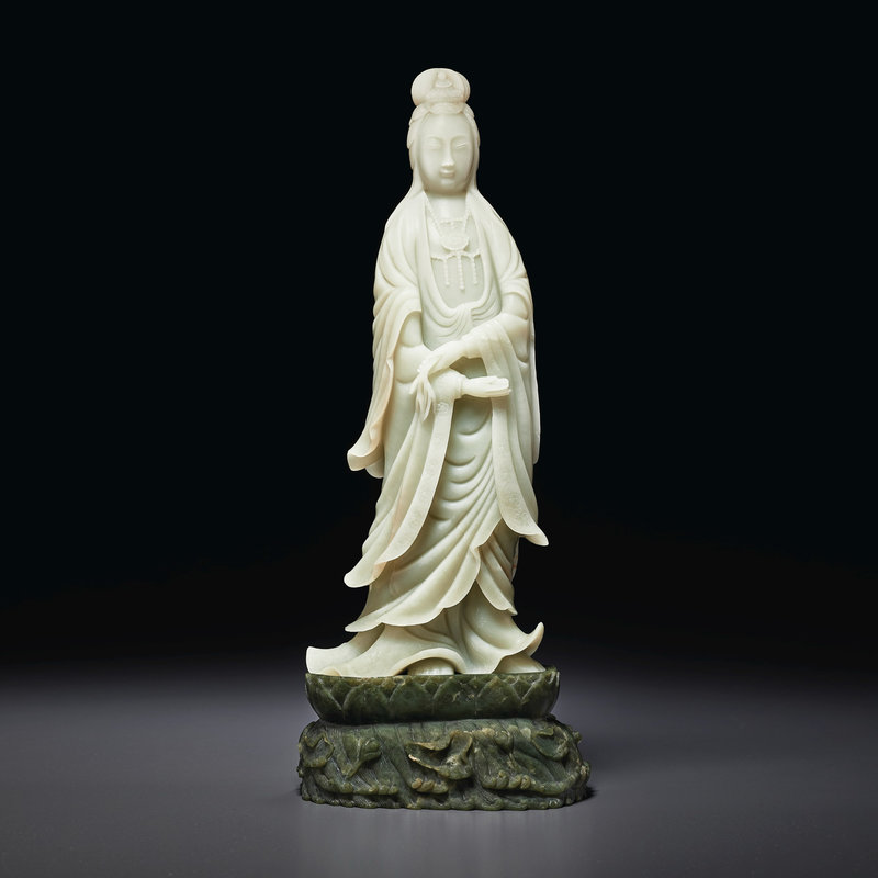A large pale greenish-white jade figure of Guanyin, Late Qing dynasty
