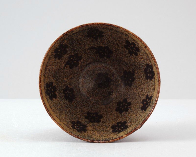 Black ware tea bowl with plum blossom decoration, Jizhou kiln-sites, 12th - 13th century, Southern Song Dynasty (1127 - 1279)