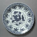 Plate with Grapes and Floral Sprays, Xuande reign (1426-1435), Ming dynasty (1368-1644), China, Jiangxi province, Jingdezhen, porcelain with underglaze blue decoration, Diameter - w:43.20 cm (w:17 inches)Overall - h:7.70 cm (h:3 inches). Anonymous Gift 19