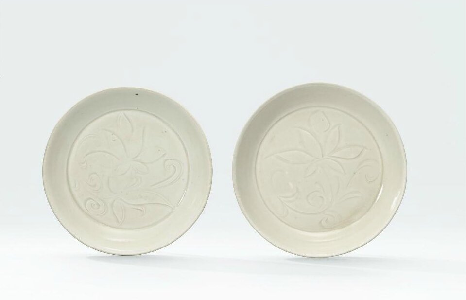Two small carved Ding 'lotus' dishes, Northern Song dynasty (960-1127)