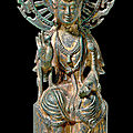 A rare inscribed gilt-bronze figure of avalokitesvara, sui dynasty (581-618)