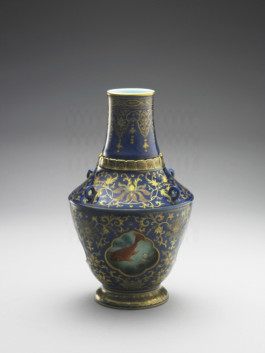 Vase, painted gold on indigo ground, with revolving interior with swimming fishes design in fencai overglaze enamel, Jingdezhen ware, Qing dynasty, Qianlong era (1736–1795). National Palace Museum, Taipei.