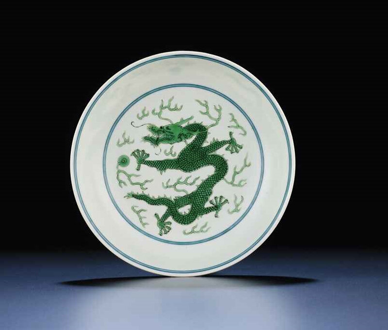 A very fine green-enamelled 'dragon' saucer dish, Qianlong six-character sealmark and of the period (1736-1795)