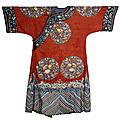 A lady's informal kesi red-ground robe, changfu, 19th century