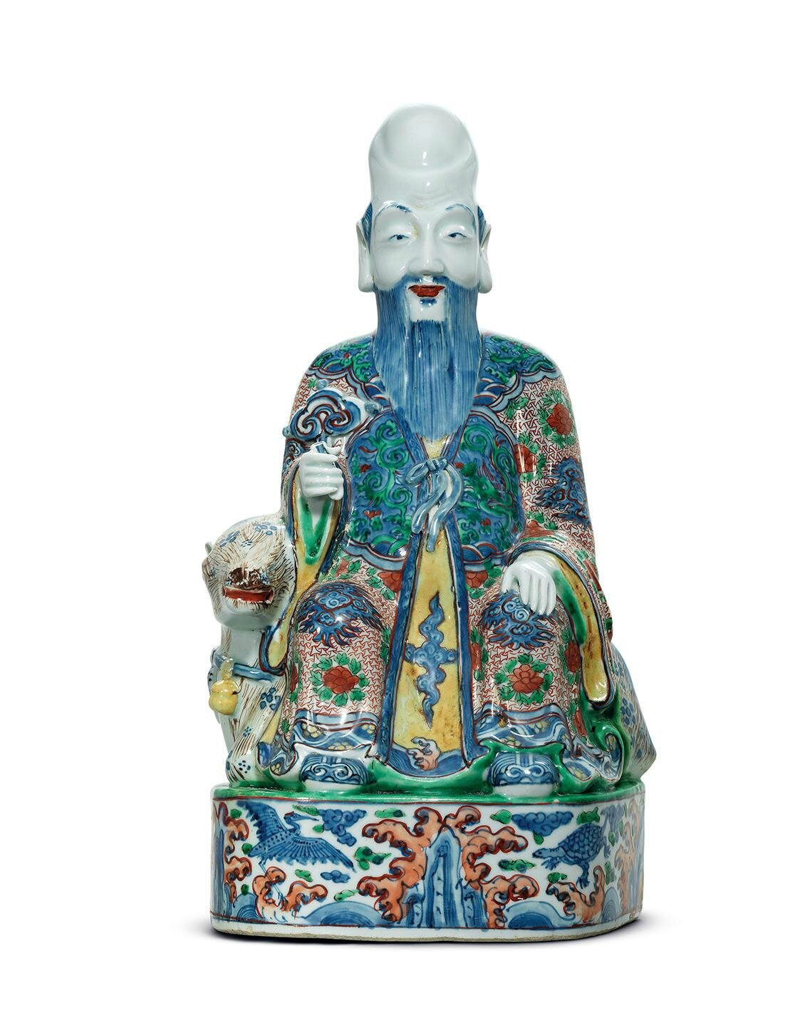 A large and rare Ming wucai seated figure of Shoulao, Wanli period (1573-162)