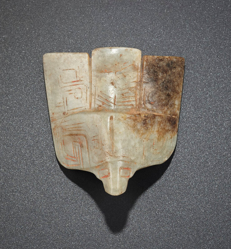 2019_NYR_16950_0820_001(a_rare_large_mottled_brown_and_greenish-beige_jade_bird-form_pendant_l)