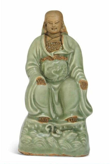 A Longquan celadon and biscuit figure of Xuan Wu, Ming dynasty, 15th-16th century
