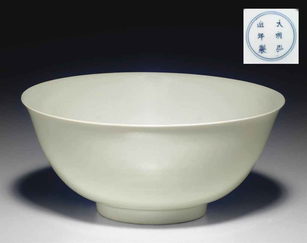 A_fine_and_rare_white_glazed_bowl__Hongzhi_six_character_mark_in_underglaze_blue_within_a_double_circle_and_of_the_period__1488_1505_