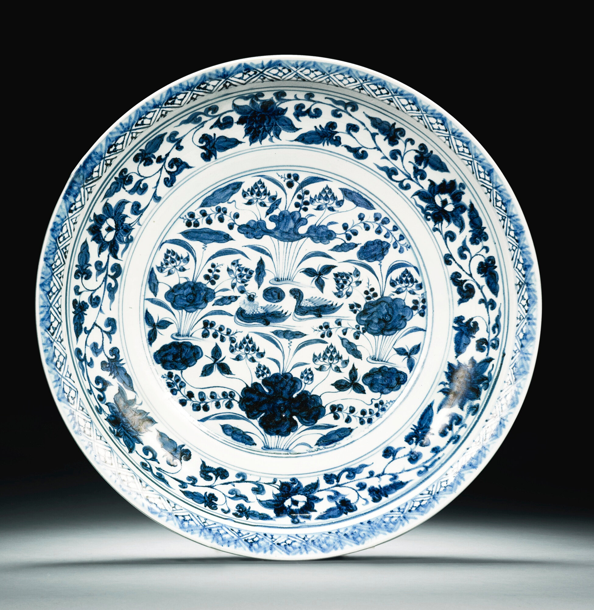 A large blue and white 'Mandarin Ducks' charger, Yuan dynasty