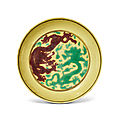A yellow-ground aubergine and green-enamelled 'dragon' dish, kangxi six-character mark and of the period (1662-1722)