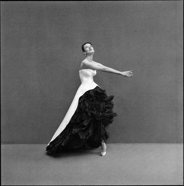 Dorian Leigh wearing evening gown of black silk organza and white cotton piqué by Balenciaga, photo by Richard Avedon, summer 1951