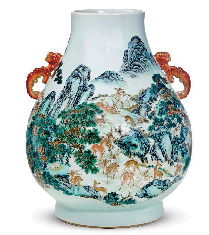 A yangcai 'hundred deer' vase with iron-red handles