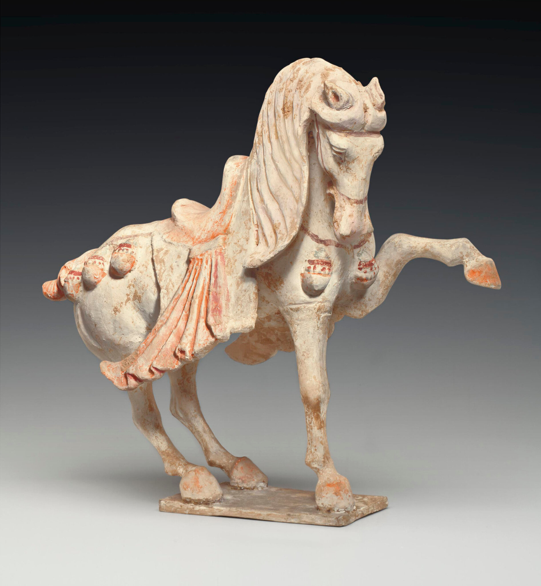 A painted pottery figure of a prancing horse, Tang dynasty (618-907)