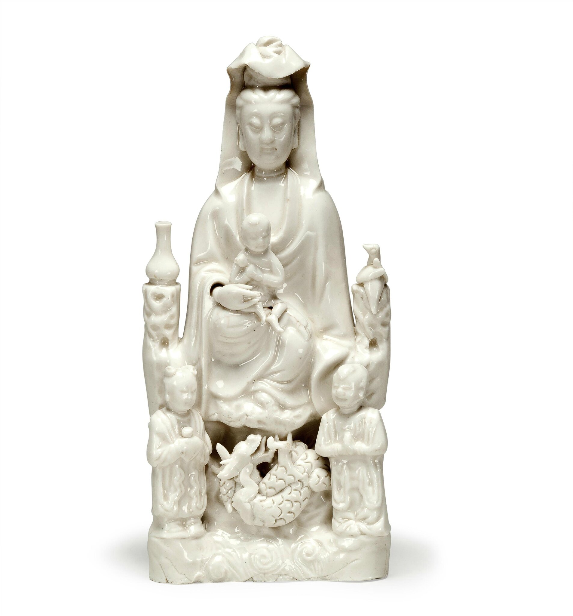 A Dehua figure of seated Guanyin, 17th century