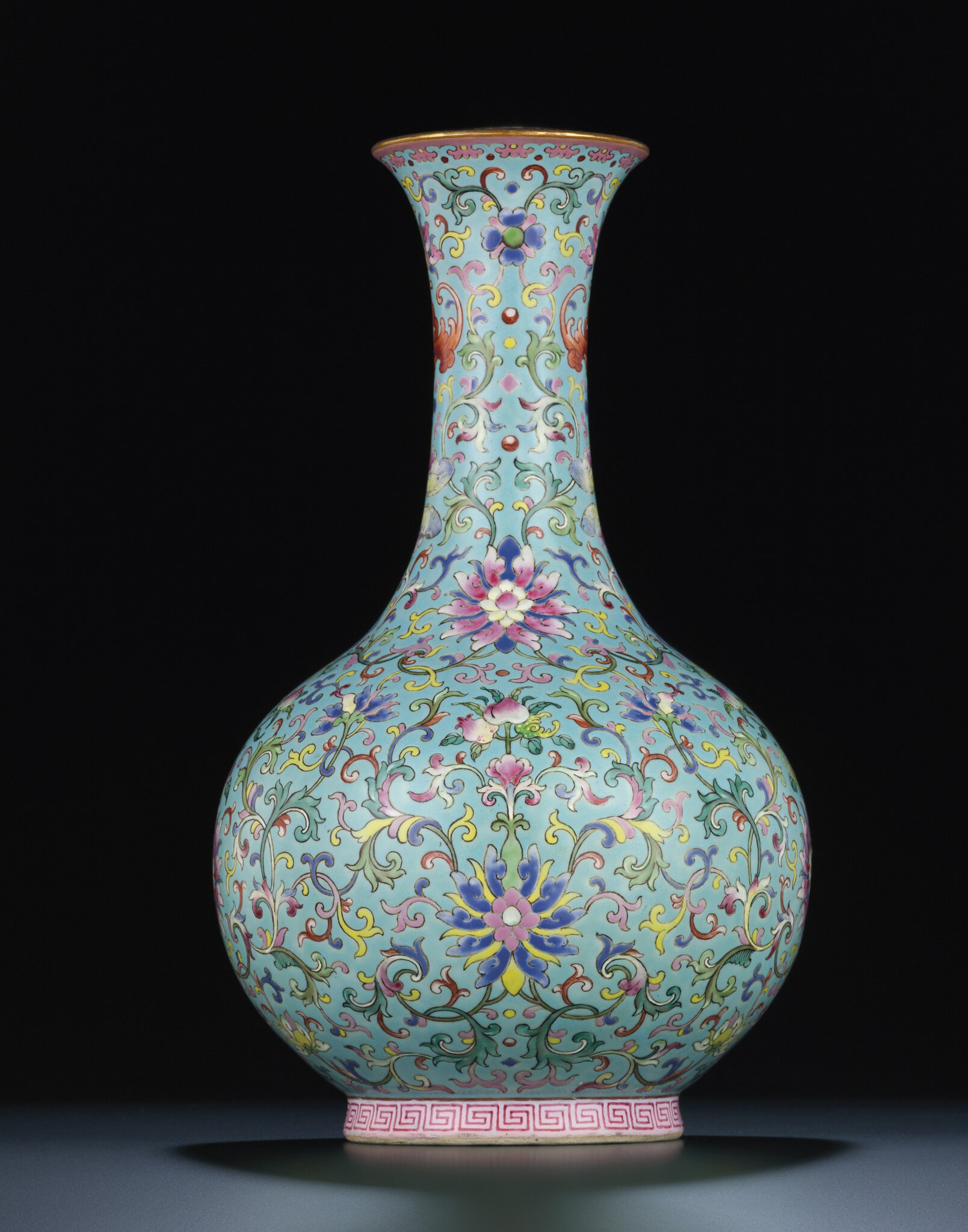 A rare turquoise-ground famille rose bottle vase, Qianlong iron-red six-character sealmark and of the period (1736-1795)