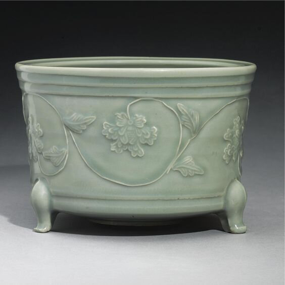 A large 'Longquan' Celadon Tripod Censer with applied decoration, Yuan dynasty (1279-1368)