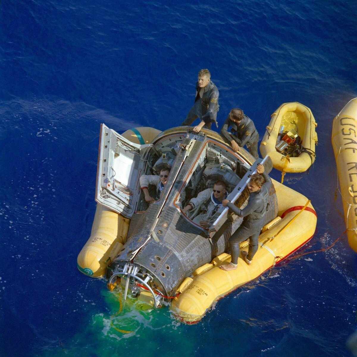 Neil Armstrong and David Scott looking badass as their Gemini 8 Capsule is being recovered, 1966