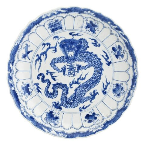 A blue and white 'dragon' dish.Bearing Xuande six-character mark, but Kangxi.Photo Bonhams.