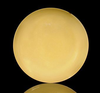 8. A yellow glazed dish, Hongzhi mark and of the period (1488-15