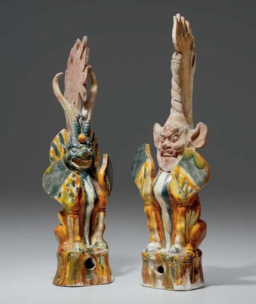 A_pair_of_blue_and_sancai_glazed_pottery_figures_of_earth_spirits__Tang_dynasty__618_907__