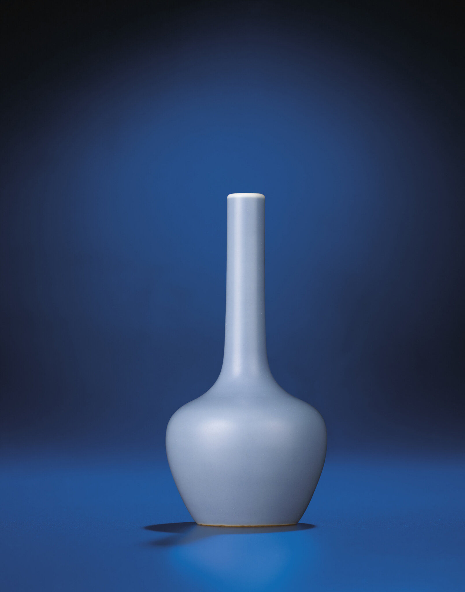 A fine and very rare lavender-glazed bottle vase, Yongzheng six-character mark within double-squares and of the period (1723-1735)