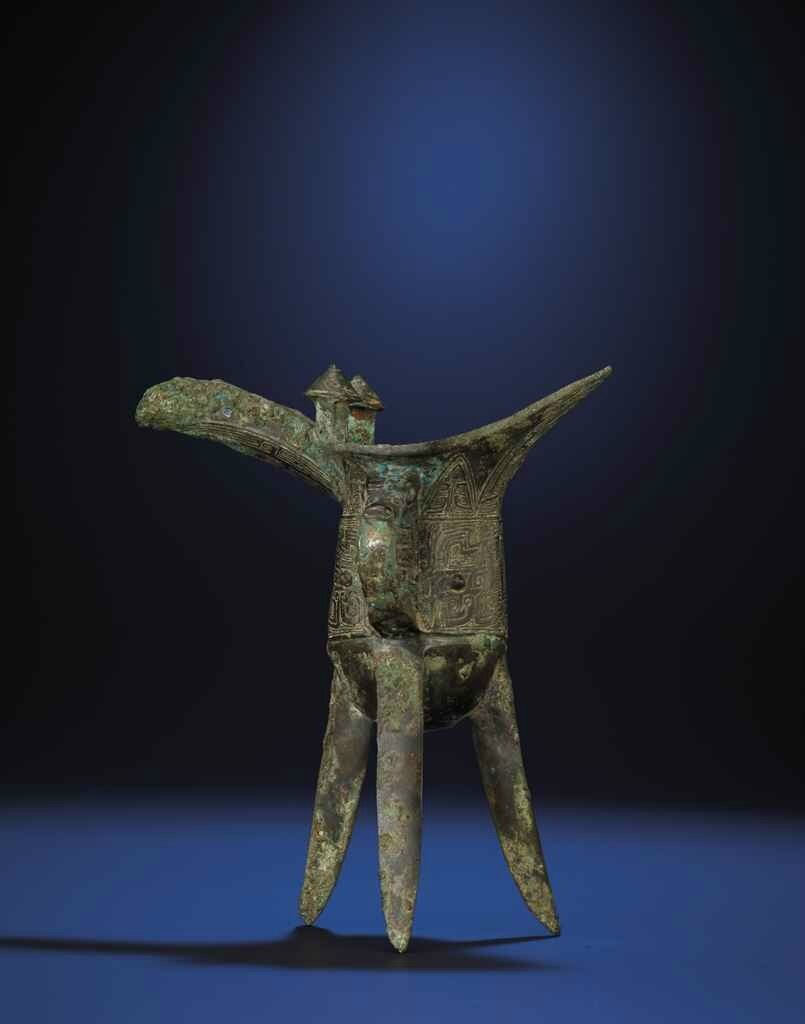 An archaic bronze ritual tripod vessel, shijue, Late Shang dynasty, Late Anyang period, 12th-11th century BC