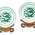 A pair of green-enamelled 'dragon' dishes, seal marks and period of qianlong (1736-1795)