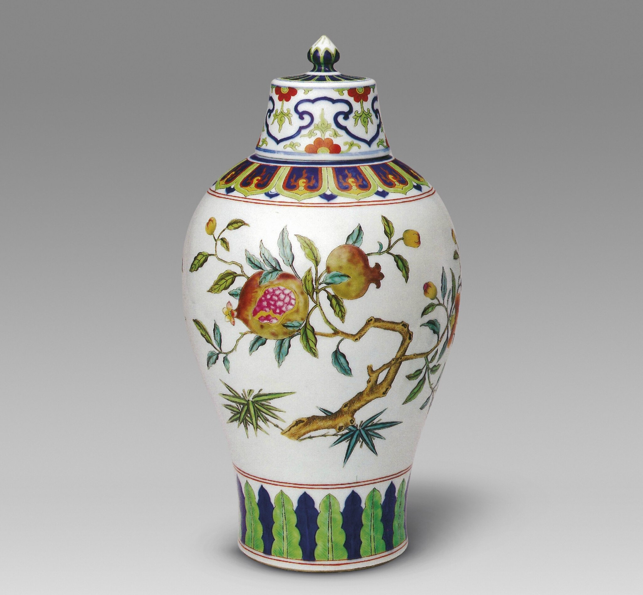 A Fine and very Rare famille Rose and Underglaze-Blue Decorated 'Pomegranate' meiping and cover, Qianlong Six-Character Seal Mark And Of The Period (1736-1795); 32.5 cm. high in the Qing Court Collection, Palace Museum.