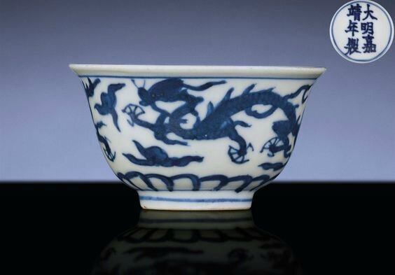 A Ming blue and white 'dragon' winecup, Jiajing six-character mark within a circle and of the period (1522-1566) (2)