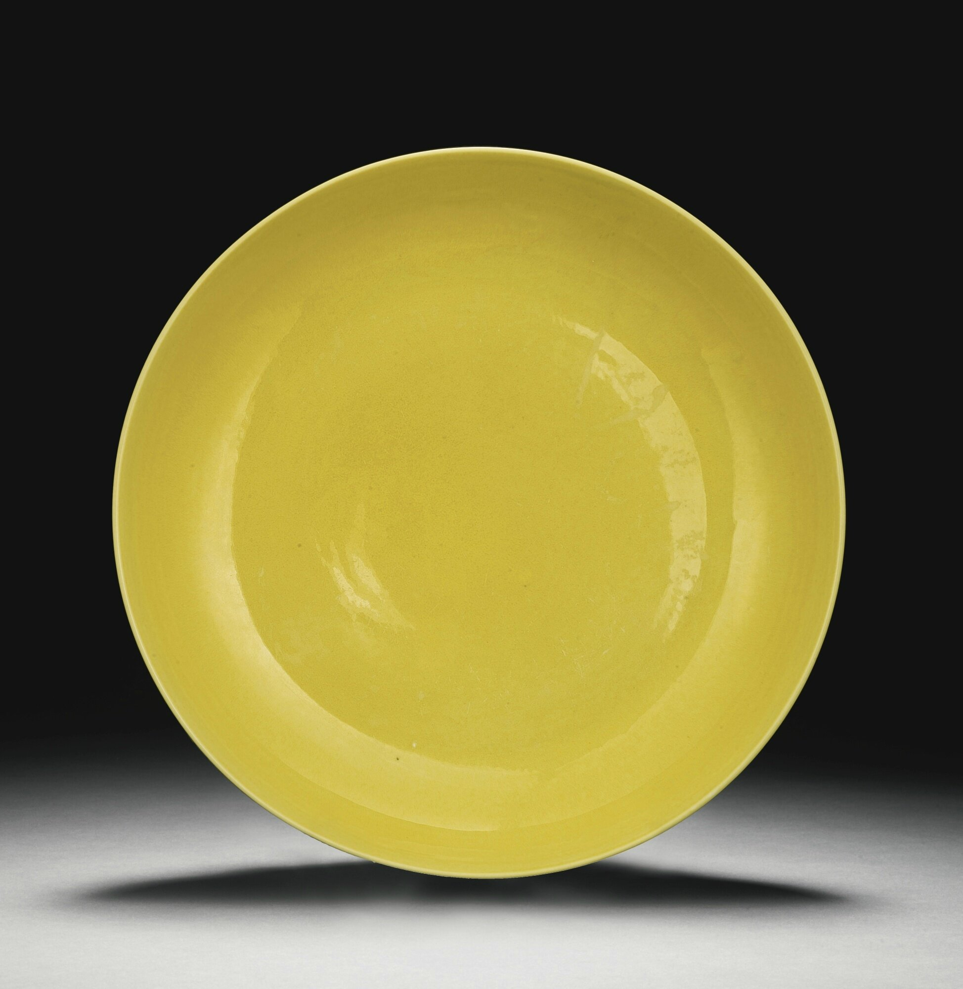 A yellow-glazed dish, Zhengde mark and period (1506-1521)