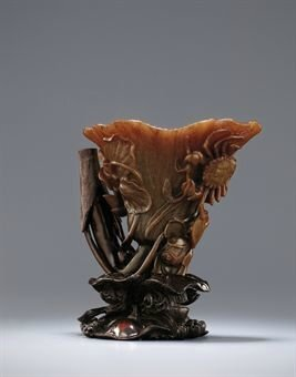 A rare and supberly carved lotus-leaf shaped rhinoceros horn waterdropper