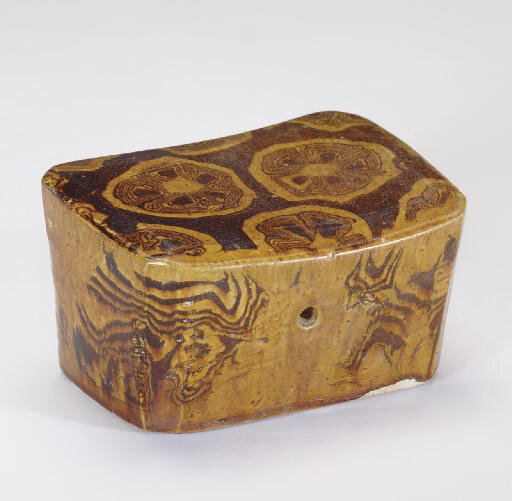 A small amber-glazed marbled pillow, Tang dynasty, 8th-9th century