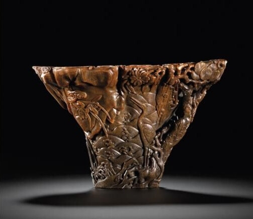 A large rhinoceros horn libation cup with cranes, 17th century
