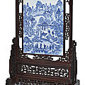 An impressive blue and white 'immortals' plaque on a hardwood stand, qing dynasty