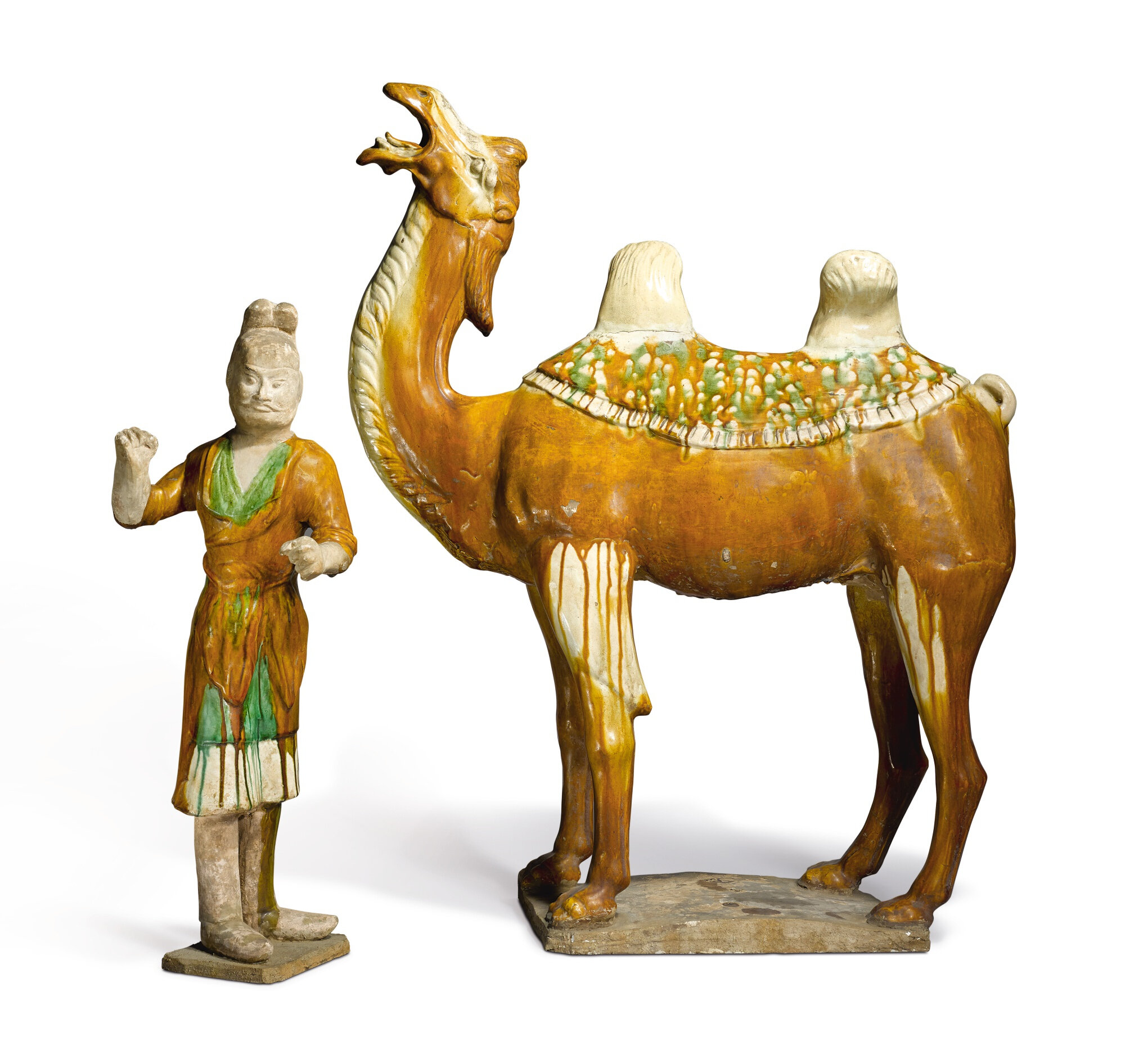 A large sancai-glazed pottery figure of a camel and groom, Tang dynasty (618-907)